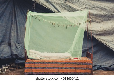 Outdoors bed with a green mosquito net in Bhaktapur, Nepal