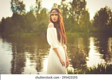 Outdoors fashion  photo of beautiful bohemian lady at river
