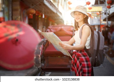 Outdoors lifestyle of beautiful young woman.  smiley beautiful  woman standing in front of festival outdoor market famous with backpack , tourism shopping  Festive mood, Traveler and holidays,