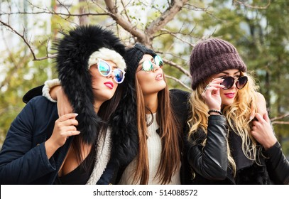 489f12b8d17ea Outdoors lifestyle fashion portrait of three pretty girls friends