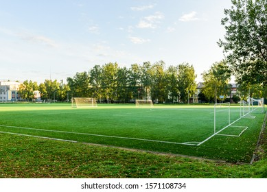 Outdoors mini football court with artificial turf. Football goal grass of a city stadium.