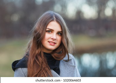 Outdoors portrait of beautiful young brunette girl.