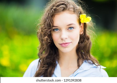 Outdoors portrait of beautiful young girl. Spring color background.