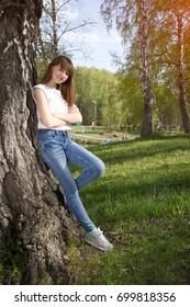 Outdoors portrait of beautiful young girl. Portrait of Teenage girl near birch tree.