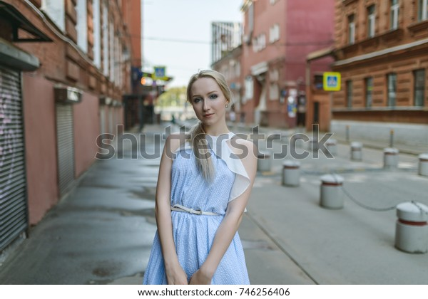 Outdoors portrait of beautiful young woman. Selective focus.