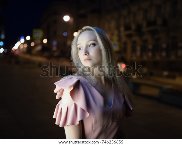 Outdoors portrait of beautiful young woman at night.