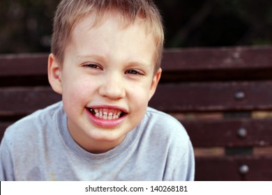 Outdoors portrait of cute 5 years old child boy