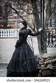 Outdoors portrait of a victorian lady in black