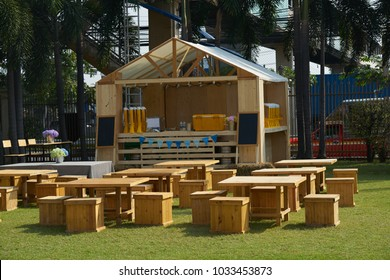 outdoors restaurant tables and chairs and counter front in grass garden day time