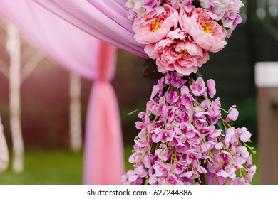 Outdoors wedding decoration with orhid and peony bouquets