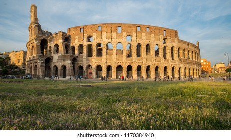 Outer view of Colosseum with tourists moving around