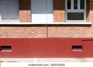 The outer wall of the orange building Overlooking the brick laying