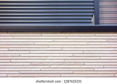 Outer wall siding and  metallic roll up door