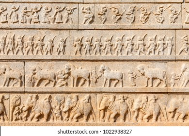 outer walls of the Hazara Rama temple show Hindu festive procession, Hampi, Karnataka, India