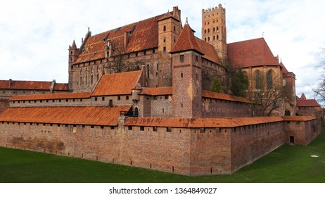 outer walls of largest castle in the world, Malbork castle (Marienburg), located in Zulawy region, Pomerania, Poland, Eastern Europe, medieval castle built in 13th century by Order of Teutonic knights