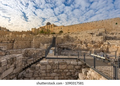 The outer walls of the old city of Jerusalem with the dome of the Al-Aqsa Mosque in the background