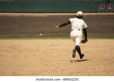 Outfielder have fielding practice.She watch ball and run for.