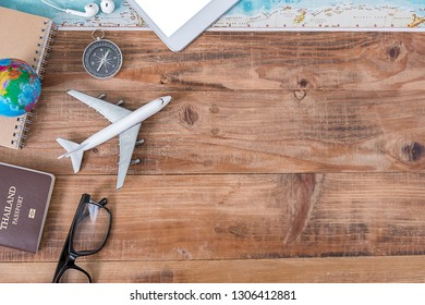 Outfit and accessories of traveler with copy space, Travel concept.Overhead view of Traveler's accessories, Essential vacation items, Travel concept on wooden background. top view.