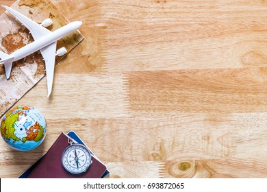 Outfit and accessories of traveler on blue background with copy space, Travel concept.Overhead view of Traveler's accessories, Essential vacation items, Travel concept on wooden background. top view