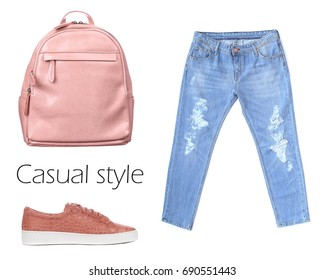 Outfit of casual woman. Jeans, leather backpack, sneakers isolated on white background. Top view. Pale colors fashion set