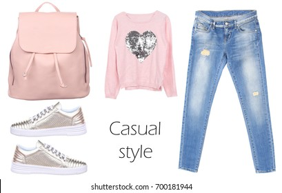 Outfit of casual woman. Jeans, leather backpack, silver sneakers, pink pullover isolated on white background. Top view. Pale colors fashion set