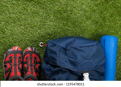 outfit for extreme sports lies on green grass