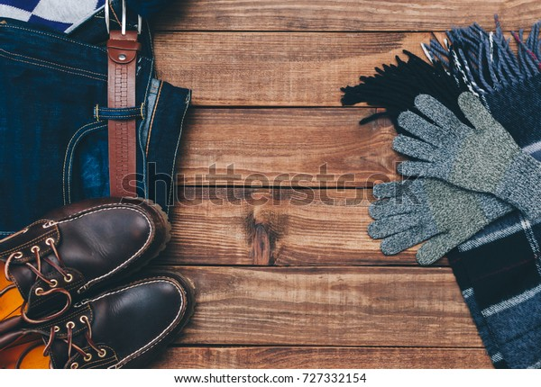 Outfit man autumn clothes on wooden background