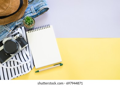 outfit traveler with blank notebook and pen on colorful background.copy space for your text concept.