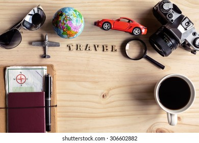 Outfit of traveler with cup of coffee on wooden background and copy space, Vintage tone, Travel concept