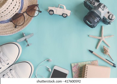 Outfit of traveler on green background with copy space, Travel concept
