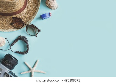 Outfit of traveler on green background with copy space, Summer and Travel concept