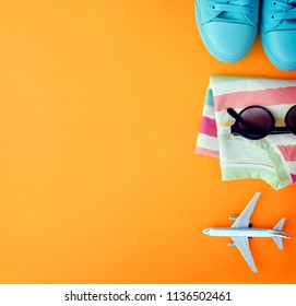 Outfit of traveler on orange background with copy space, Travel concept
