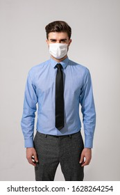 outfit with virus protection. elegant man with tie wearing a mouth protection against contagious diseases