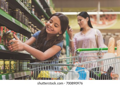 Outgoing little girl keeping food in hand