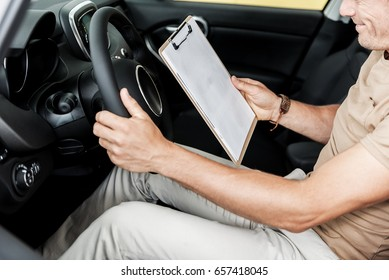 Outgoing male looking through automobile data