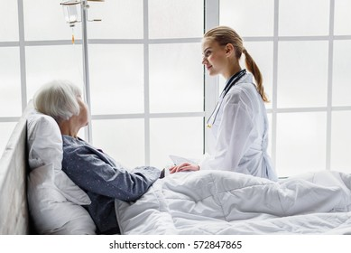 Outgoing physician monitoring physical condition of retiree