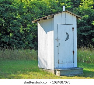 An outhouse in a field in Michigan