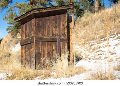 Outhouse on a snowy mountain hillside in colorado