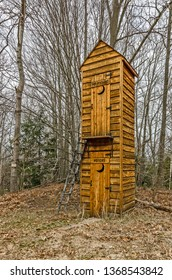 Outhouse for politicians and voters with crescent moons on both the upper and lower doors plus a convenient ladder for the second story