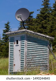 outhouse with satellite dish on top, Newfoundland