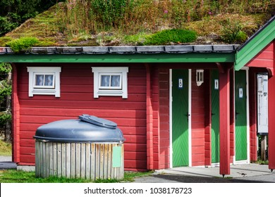outhouse toilet with locked doors in rural area of Norway