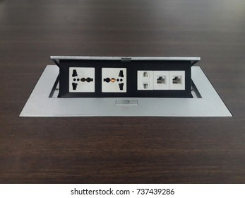 Outlet plug on the table