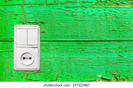 outlet and switch on the background of wooden wall