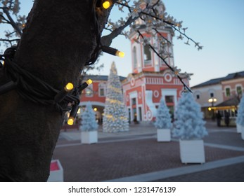 Outlet Village Belaya Dacha. Panoramic image of the street with shop. Blur christmas lights , low depth of focus with copyspace