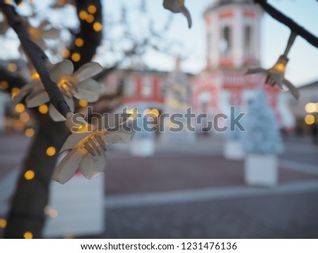 49404b6756565 Outlet Village Belaya Dacha. Panoramic image of the street with shop. Blur  christmas lights