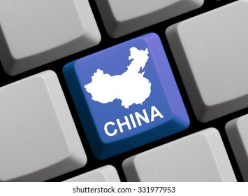 Outline of China on a blue computer Keyboard