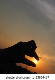 Outline of hand making animal shape and sun .