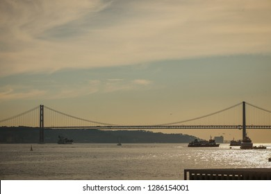 Outline of pont de 25. abril or bridge of 25. april in Lisbon, Spain on a sunset of a sunny summer day.