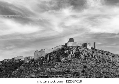 Outlined on a hilltop are the ruins of the Castle of Xiquena in Lorca, Murcia, Spain