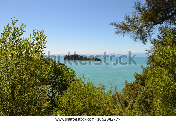 outlook on beautiful small island in the middle of blue sea